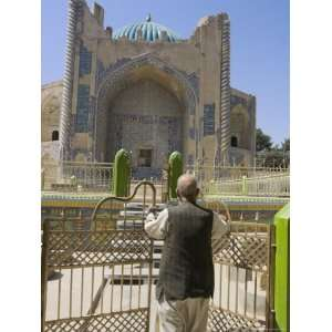 Man Opening Doors to Collection of Graves in Front of Shrine of Khwaja