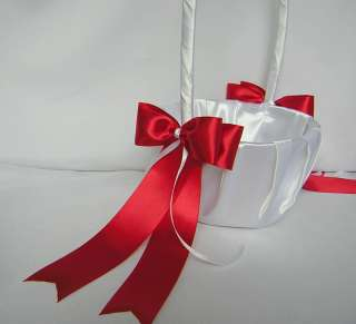 red satin bows and strands of white satin ribbons
