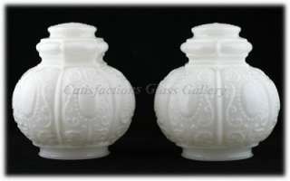 on this pair of vintage milk glass globe shaped lamp shades eludes me