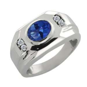 68 Ct Oval Sapphire Blue Mystic Topaz and Diamond 14k White Gold Ring