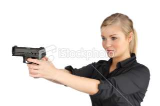 Women holding 9mm gun Royalty Free Stock Photo